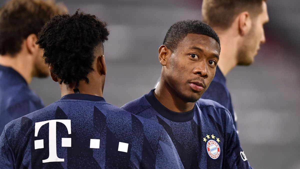 David Alaba of FC Bayern Munich warms up prior to the Bundesliga match between FC Bayern Muenchen and RB Leipzig