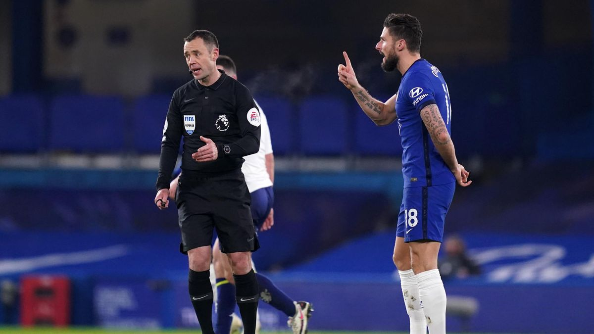 LONDON, ENGLAND - DECEMBER 28: Olivier Giroud of Chelsea interacts with match referee, Stuart Attwell after Aston Villa's first goal scored by Anwar El Ghazi (Not pictured) during the Premier League match between Chelsea and Aston Villa at Stamford Bridge