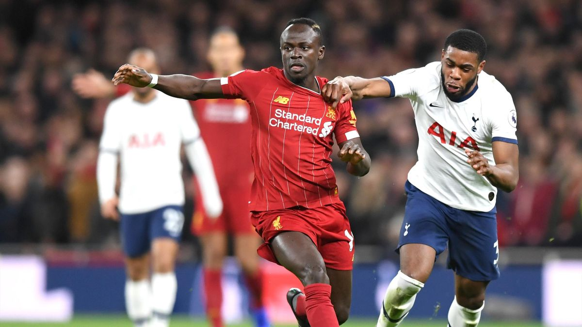 Sadio Mane of Liverpool runs with the ball from Japhet Tanganga of Tottenham Hotspur during the Premier League match between Tottenham Hotspur and Liverpool FC