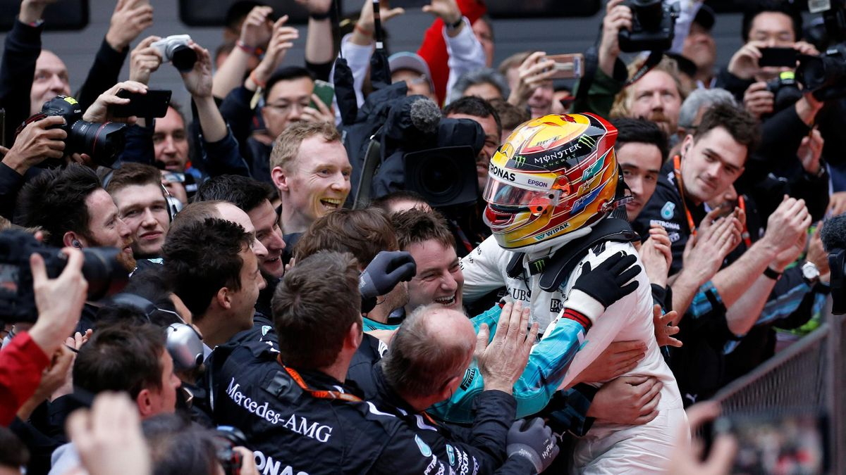 Mercedes driver Lewis Hamilton of Britain celebrates after winning the Chinese Grand Prix at the Shanghai International Circuit.