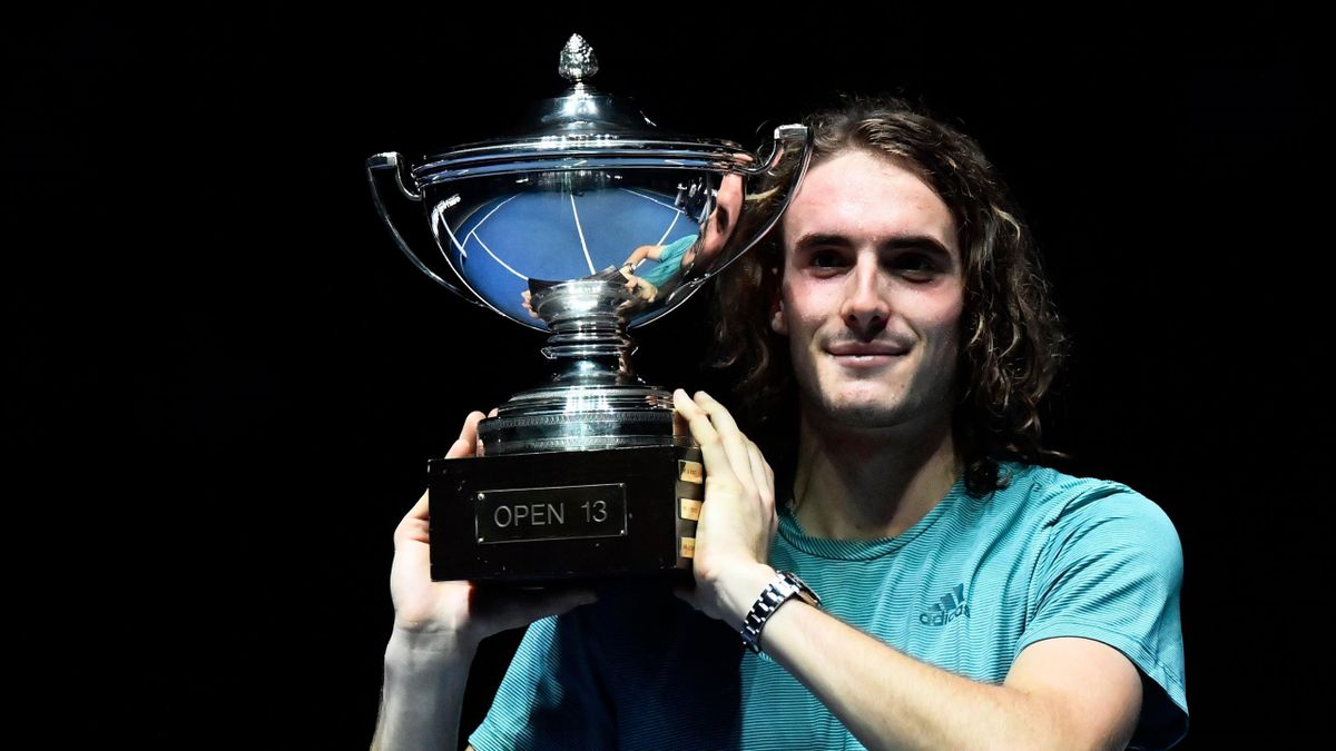 Greece's Stefanos Tsitsipas poses with the trophy