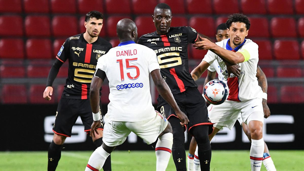 ennes' French forward Serhou Guirassy (2ndR) is challenged by Paris Saint-Germain's Brazilian defender Marquinhos (R) during the French L1 football match between Stade Rennais Football Club and Paris Saint-Germain at the Roazhon Park stadium in Rennes,