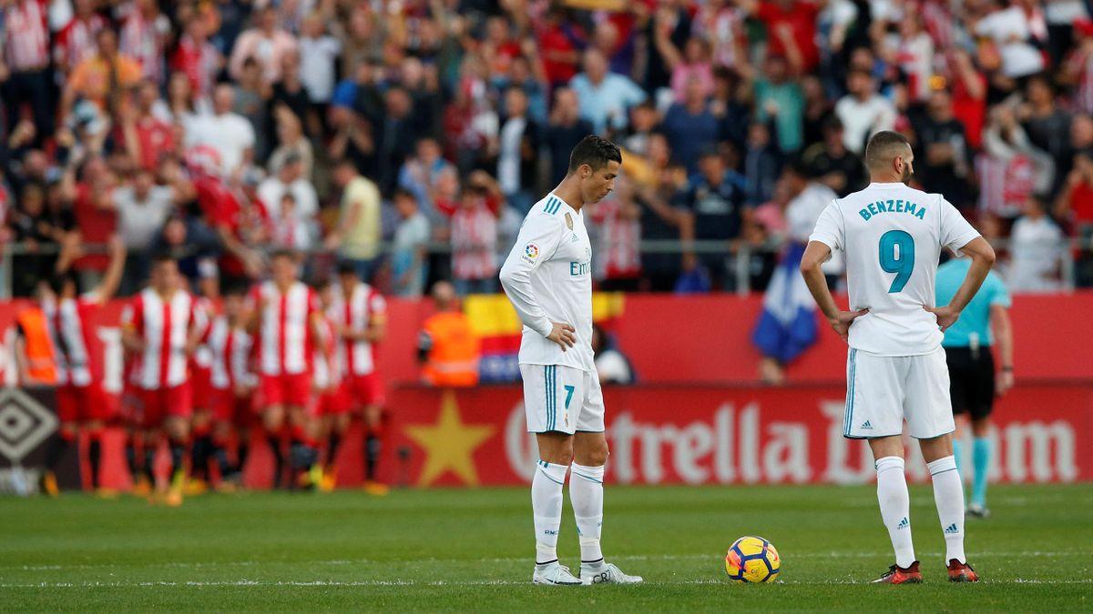 Cristiano Ronaldo and Karim Benzema prepare to kick off for Real Madrid after Girona score