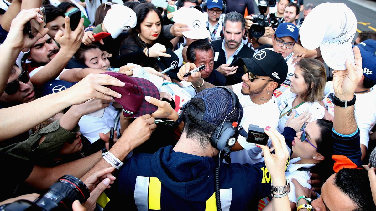Lewis Hamilton of Great Britain and Mercedes GP signs autographs for fans in the Pitlane during previews ahead of the Formula One Grand Prix of Mexico at Autodromo Hermanos Rodriguez on October 25, 2018.