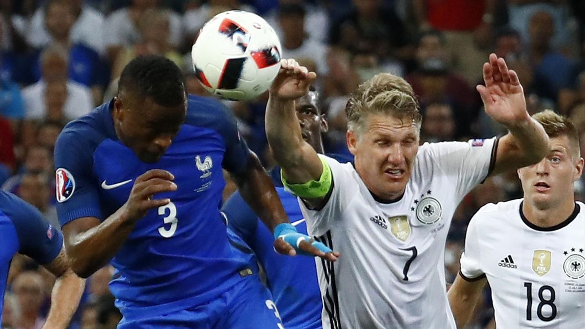 Germany's Bastian Schweinsteiger handles the ball and concedes a penalty