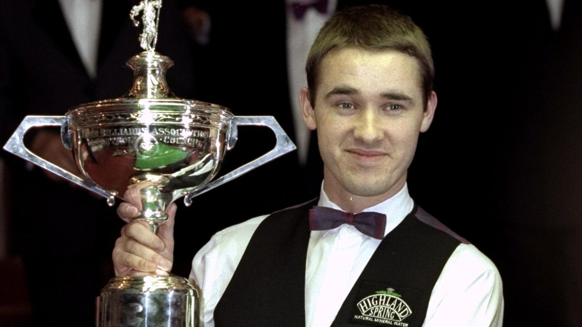 Stephen Hendry of Scotland celebrates victory with the trophy after winning the 1999 Embassy World Snooker Championships Final match against Mark Williams of Wales played at the Crucible Theatre in Sheffield, England.