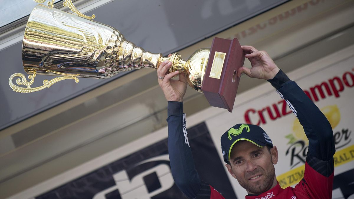"""Movistar's Spanish cyclist Alejandro Valverde celebrates on the podium winning the first stage of the """"Ruta del Sol"""""""