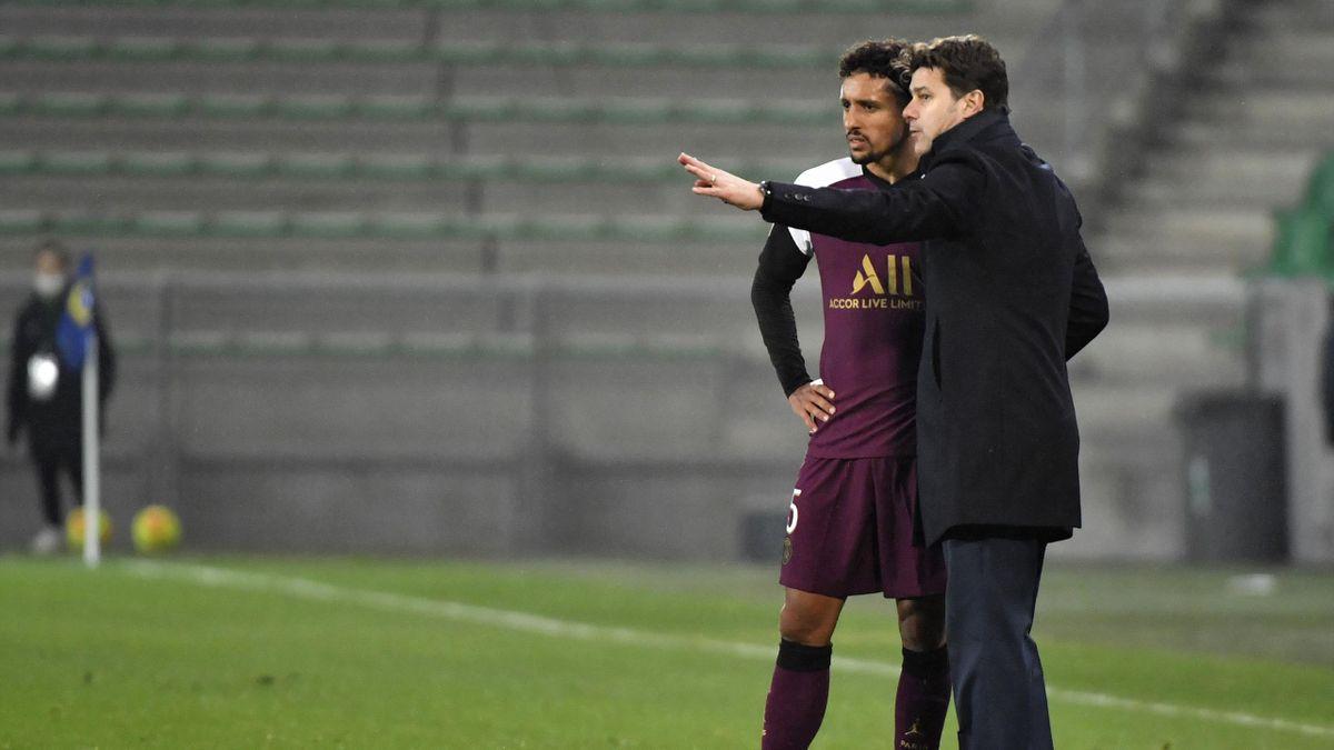 Paris Saint-Germain's Argentinian coach Mauricio Pochettino speaks to Paris Saint-Germain's Brazilian defender Marquinhos