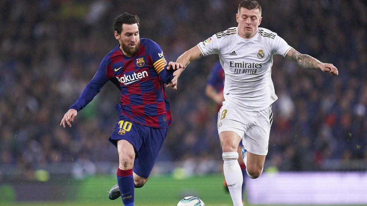 Stehen sich am Samstag im Clásico gegenüber: Reals Toni Kroos (rechts) und Barças Lionel Messi