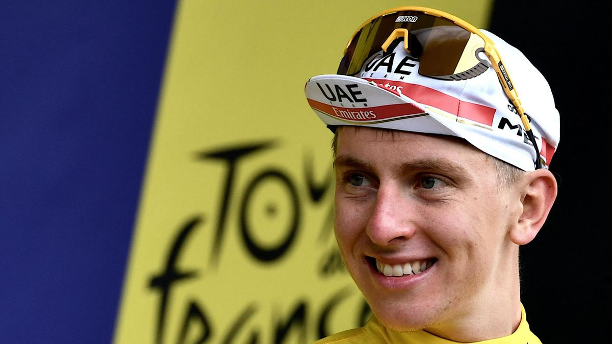 Team UAE Emirates' Tadej Pogacar of Slovenia wears the leader yellow jersey celebrates on podium after 8th stage of the 108th edition of the Tour de France cycling race, 150 km between Oyonnax and Le Grand-Bornand, on July 03, 2021.