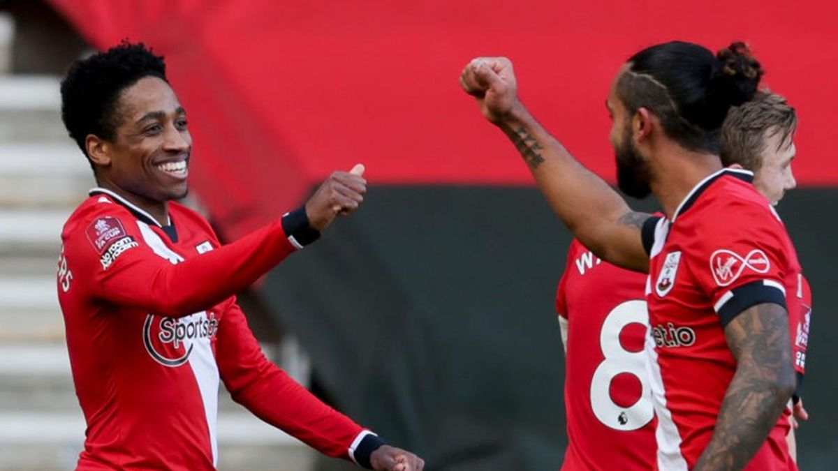 Kyle Walker-Peters of Southampton is congratulated by team-mate Theo Walcott after his shot is deflected by Gabriel of Arsenal to concede an own goal during Southampton v Arsenal, The Emirates FA Cup Fourth Round, on January 23, 2021 i