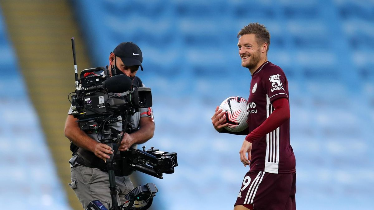 A television camera films Jamie Vardy of Leicester City with his hat-trick match ball after the Premier League match between Manchester City and Leicester City at Etihad Stadium on September 27, 2020 in Manchester, England.