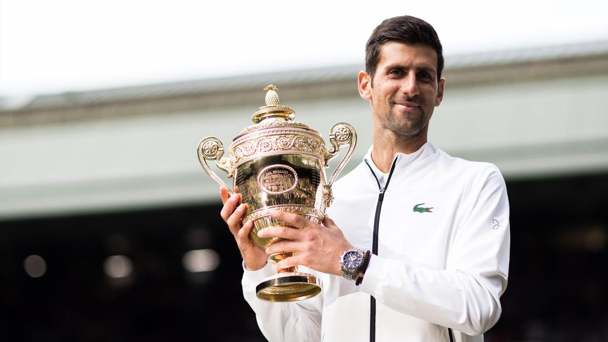 Novak Djokovic of Serbia poses with the trophy after winning the Men's Singles final against Roger Federer of Switzerland during Day thirteen of The Championships - Wimbledon 2019 at All England Lawn Tennis and Croquet Club on July 14, 2019 in London, Eng