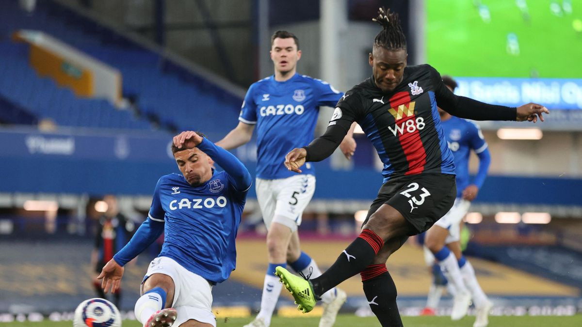 Crystal Palace's Belgian striker Michy Batshuayi shoots to score their first goal during the English Premier League football match between Everton and Crystal Palace at Goodison Park in Liverpool, north west England on April 5, 2021.