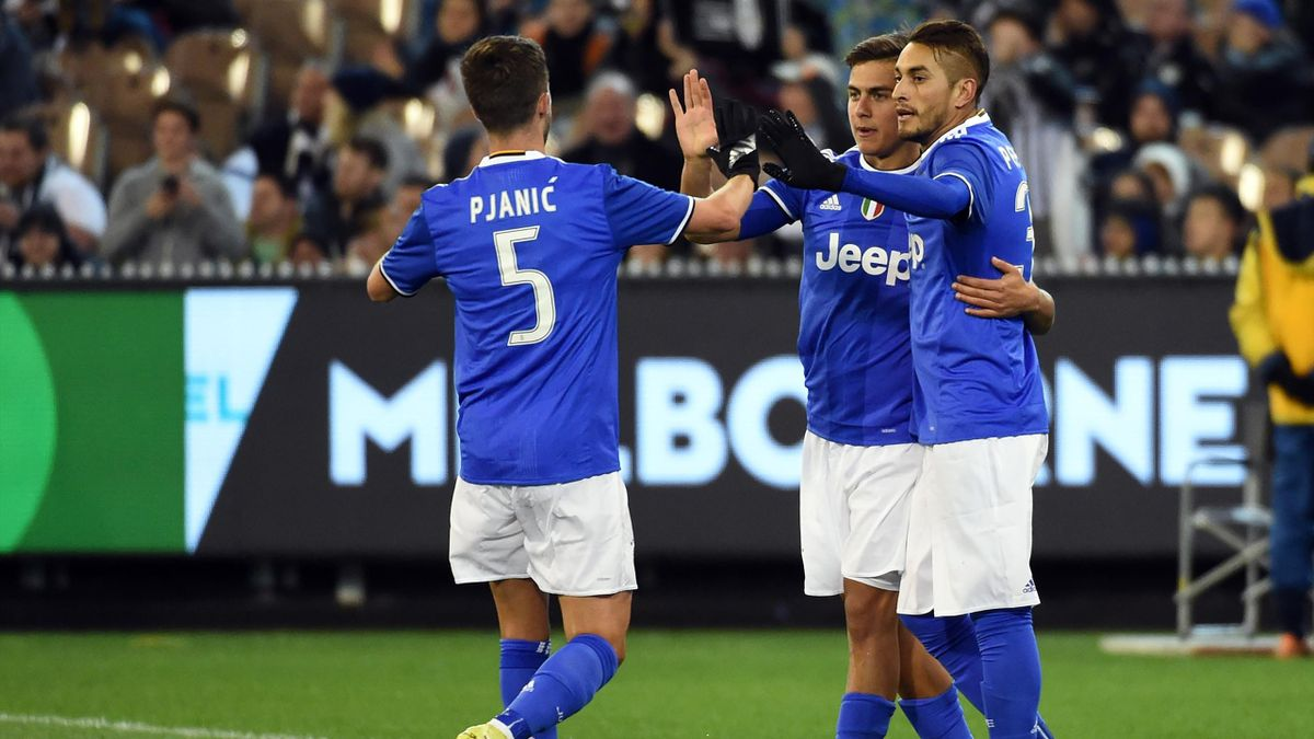 Juventus' forward Paulo Dybala (C) celebrates his goal with teammates during the International Champions Cup football match between Italy's Serie A team Juventus and Premier League team Tottenham Hotspur in Melbourne on July 26, 2016.