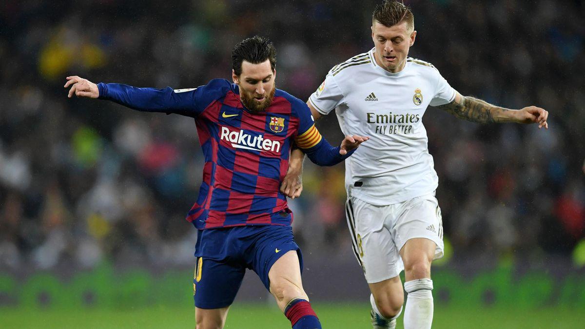 Leo Messi (l.) gegen Toni Kroos