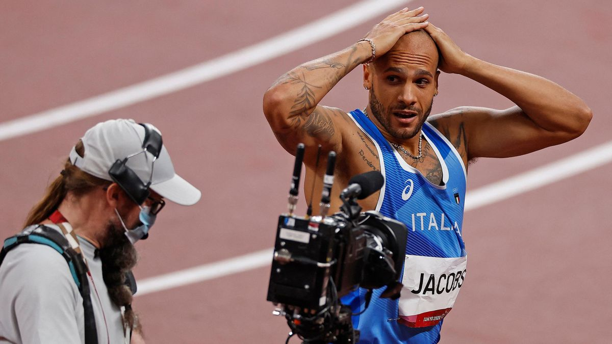 Italy's Lamont Marcell Jacobs celebrates after winning the men's 100m final during the Tokyo 2020 Olympic Games at the Olympic Stadium in Tokyo on August 1, 2021. (Photo by Odd ANDERSEN / AFP) (Photo by ODD ANDERSEN/AFP via Getty Images)