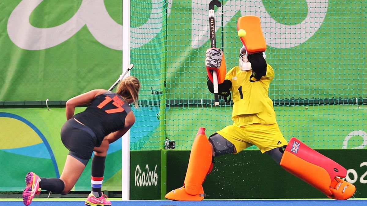 Maddie Hinch of Britain saves a penalty corner by Maartje Paumen of Netherland