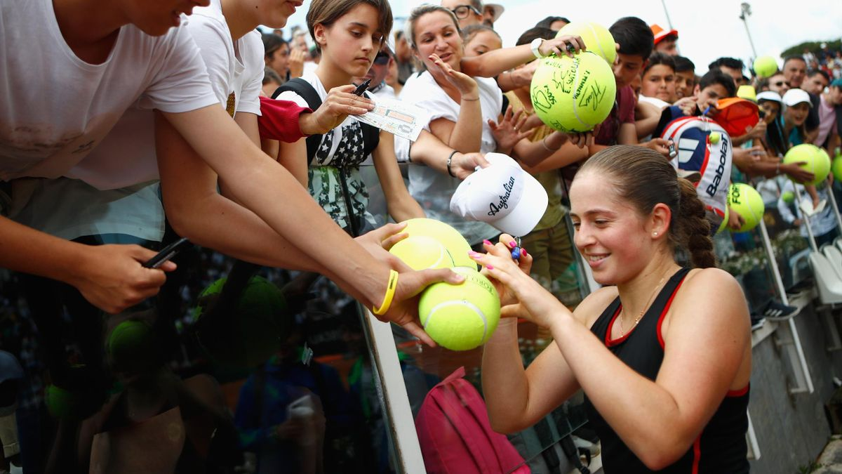 Jelena Ostapenko of Latvia signs autographs following victory in her singles match against Johanna Konta of Great Britain during day four of the Internazionali BNL d'Italia 2018 tennis at Foro Italico.