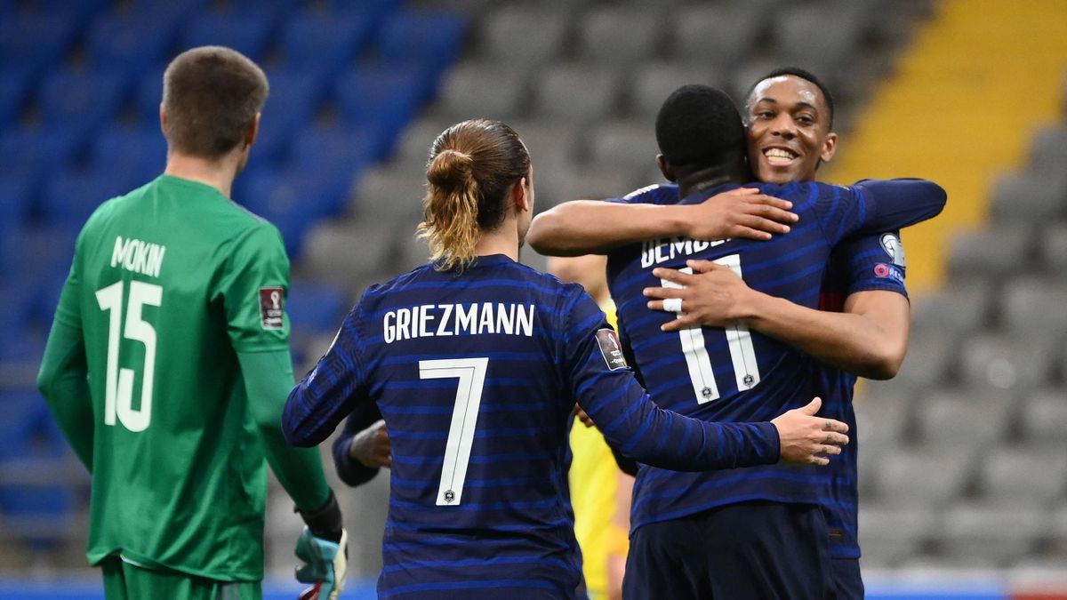France's forward Ousmane Dembele (2R) celebrates with France's forward Anthony Martial (R) after scoring a goal during the FIFA World Cup Qatar 2022 qualification Group D football match between Kazakhstan and France, at the Astana Arena, in Nur-Sultan