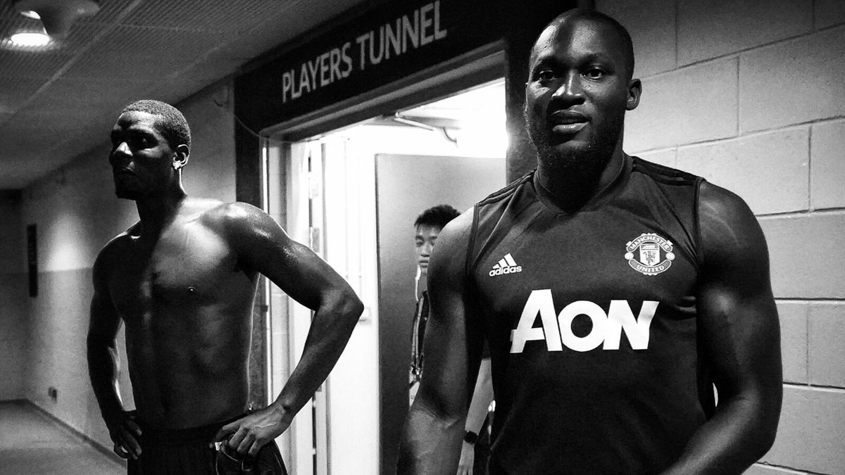 Romelu Lukaku (R) and Paul Pogba of Manchester United look on after a training session on July 19, 2019 in Singapore, Singapore.