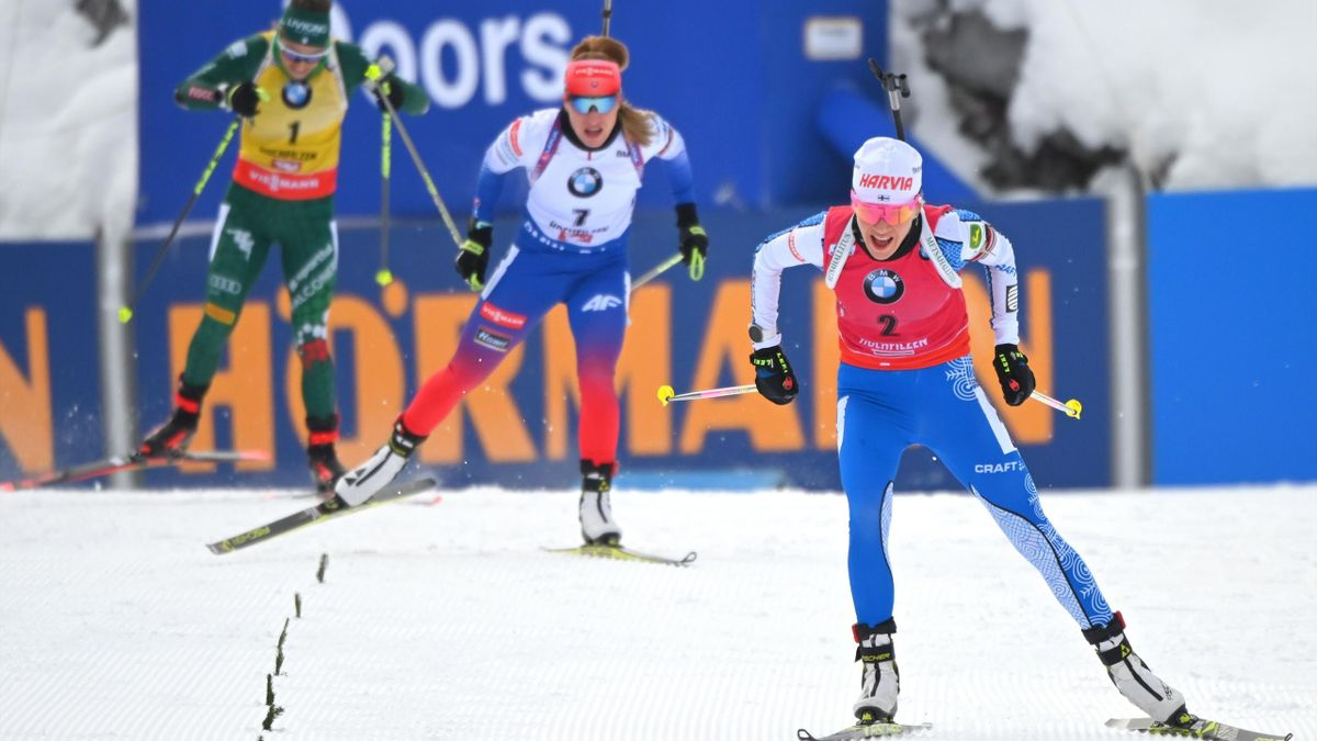 Kaisa Makarainen of Finland (front) competes to win the women's 10 km pursuit event of the IBU Biathlon World Cup, followed by second place Slovakia's Paulina Fialkova (C) and third place Italy's Dorothea Wierer in Hochfilzen, Austria on December 15, 2018