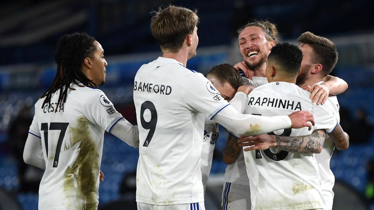 Stuart Dallas of Leeds United celebrates with team mates Helder Costa, Patrick Bamford, Raphinha and Luke Ayling of Leeds United after scoring their sides second goal during the Premier League match between Leeds United and Southampton at Elland Road on F