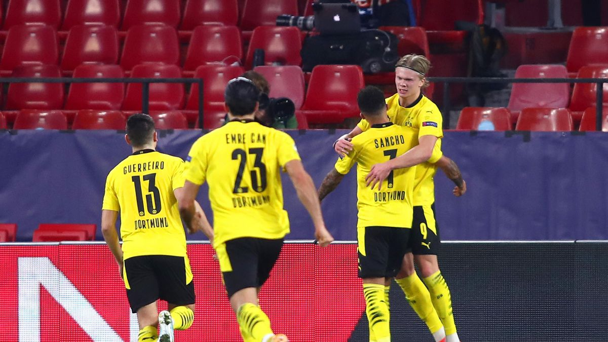 Erling Haaland of Borussia Dortmund celebrates with team mate Jadon Sancho after scoring their side's second goal during the UEFA Champions League Round of 16 match between Sevilla FC and Borussia Dortmund at Estadio Ramon Sanchez Pizjuan on February 17,