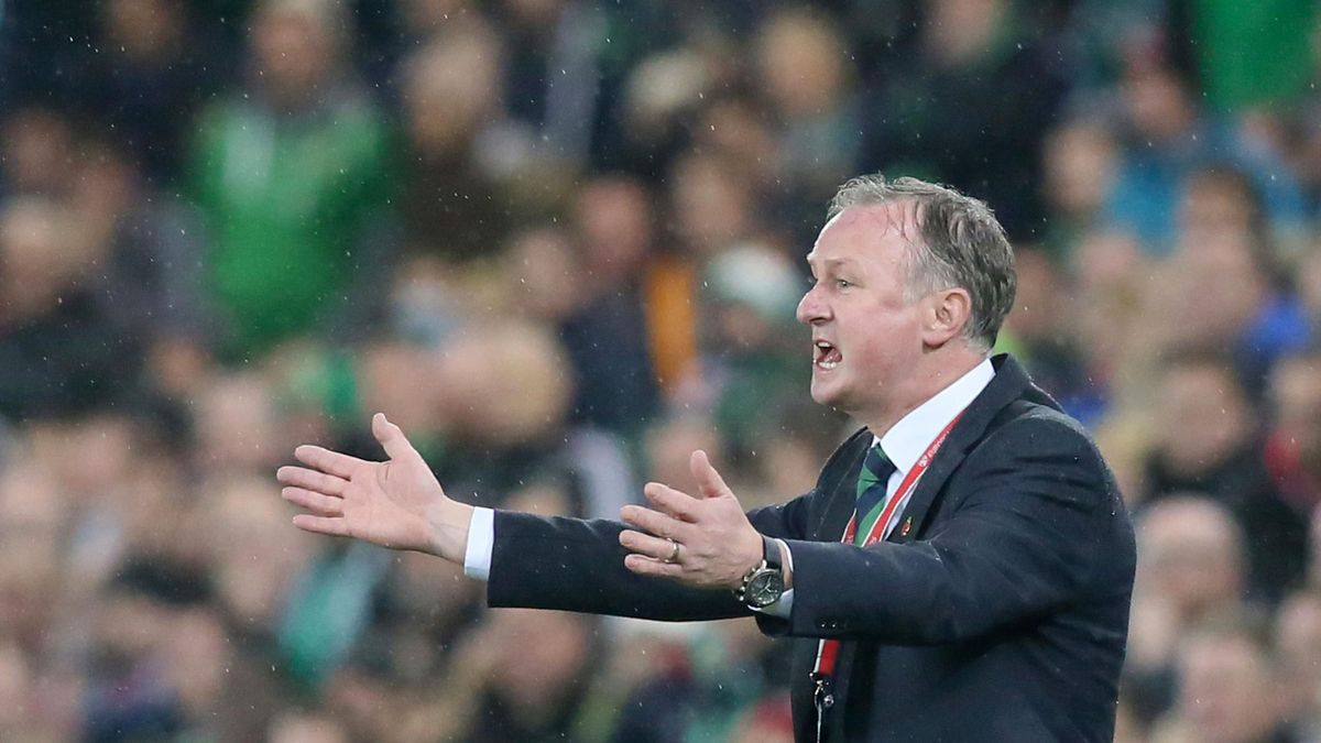 Northern Ireland's manager Michael O'Neill watches from the touchline during the FIFA 2018 World Cup qualifier second round football match between Northern Ireland and Switzerland at Windsor Park in Belfast on November 9, 2017.