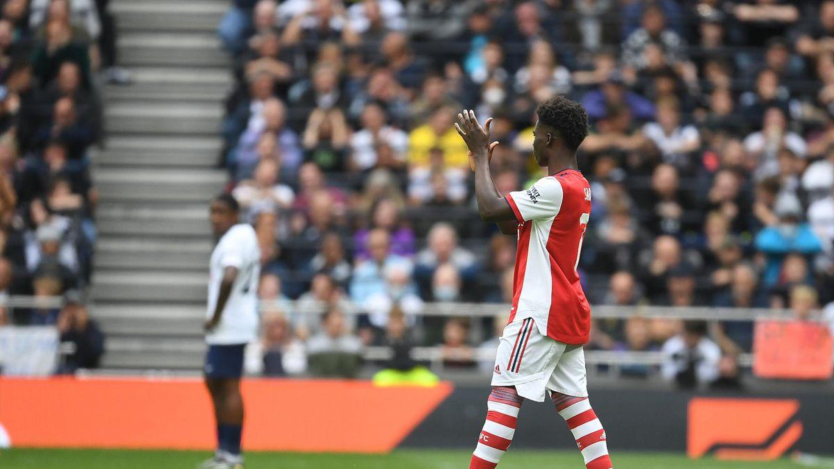 Bukayo Saka applauds the crowd in Arsenal's clash with Tottenham,  Tottenham Hotspur Stadium, London, August 08, 2021