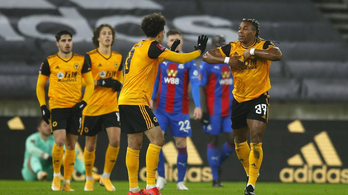 Adama Traore of Wolverhampton Wanderers celebrates scoring the first goal with Rayan Ait-Nouri during the FA Cup Third Round tie between Wolverhampton Wanderers and Crystal Place at Molineux on January 08, 2021 in Wolverhampton, England.