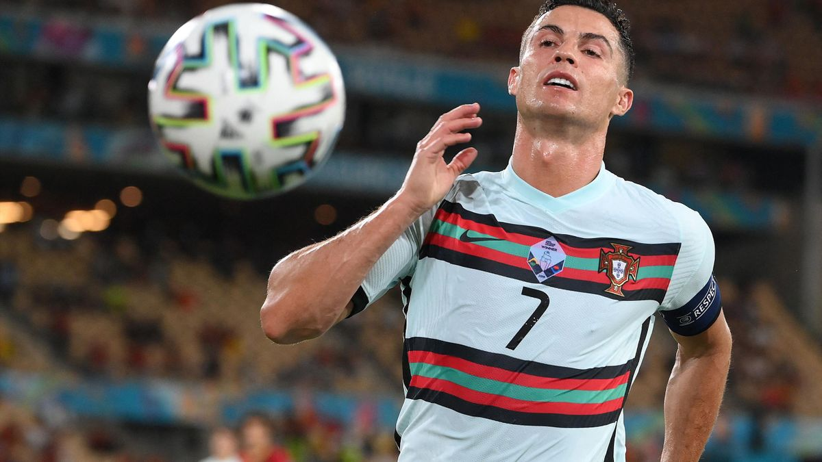 Portugal's forward Cristiano Ronaldo runs for the ball during the UEFA EURO 2020 round of 16 football match between Belgium and Portugal at La Cartuja Stadium in Seville on June 27, 2021