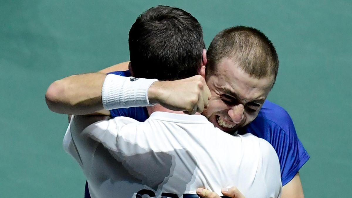 Great Britain's Daniel Evans celebrates with Great Britain's captain Leon Smith after winning the singles quarter-final tennis match against Germany's Jan-Lennard Struff at the Davis Cup Madrid Finals 2019 in Madrid on November 22