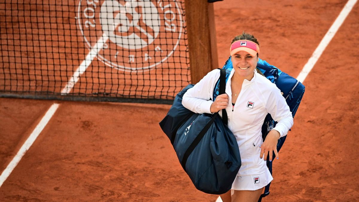 Sofia Kenin of the US celebrates and smiles as she leaves the court after winning her women's singles quarter-final tennis match against Danielle Collins of the US on Day 11 of Roland Garros
