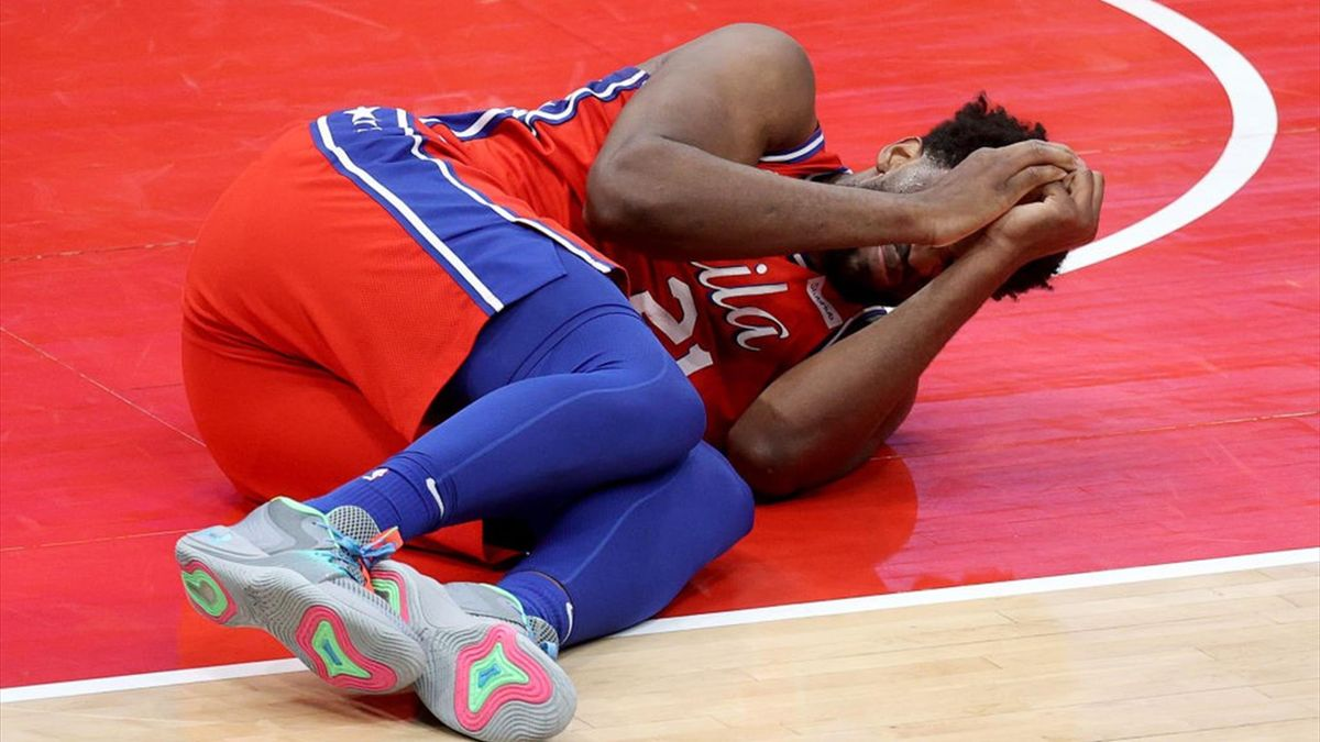 Joel Embiid #21 of the Philadelphia 76ers reacts after getting injured in the second half against the Washington Wizards at Capital One Arena on March 12, 2021 in Washington