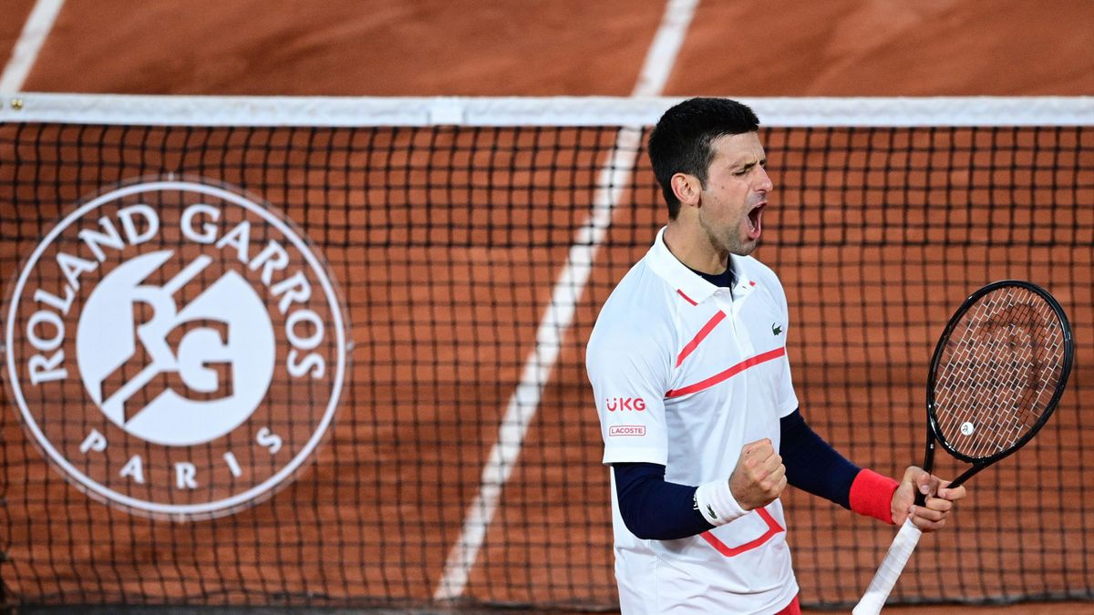 Serbia's Novak Djokovic celebrates after winning against Spain's Pablo Carreno Busta during their men's singles quarter-final tennis match on Day 11 of The Roland Garros 2020 French Open tennis tournament in Paris on October 7, 2020.