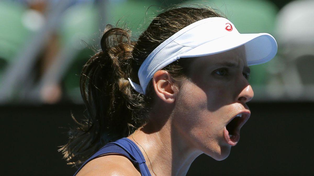 Johanna Konta reacts during her Women's singles second round match against Japan's Naomi Osaka