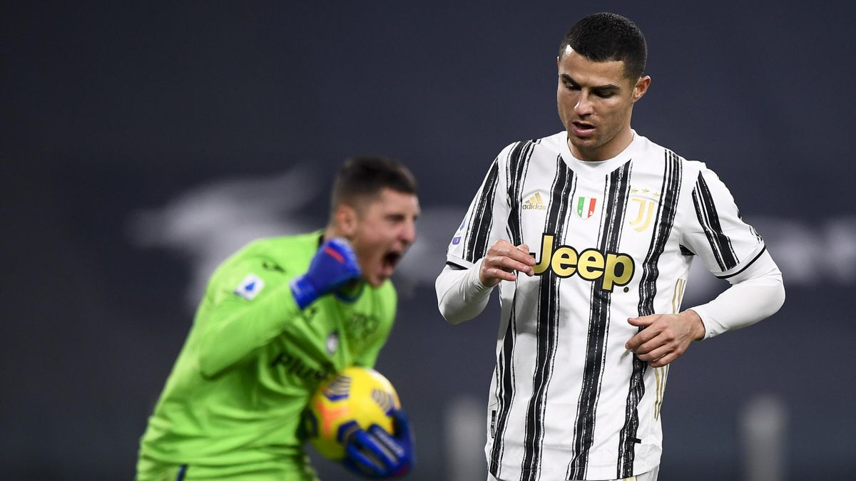 Cristiano Ronaldo looks dejected after missing a penalty v Atalanta