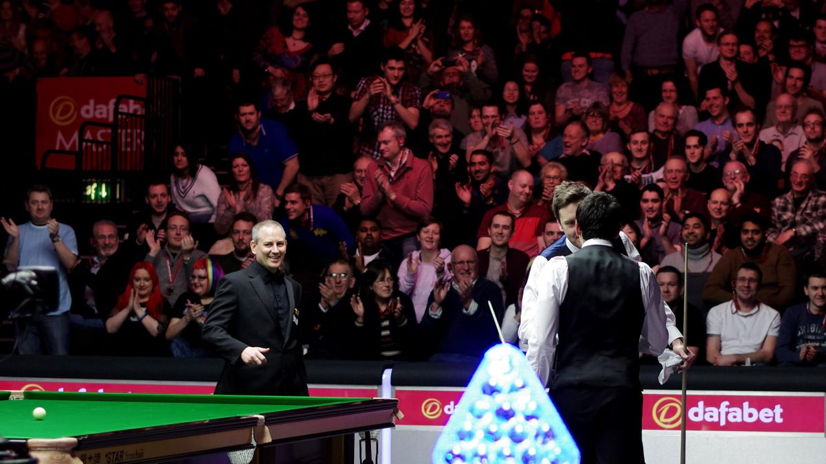 Ronnie O'Sullivan of UK stricks a triumph pose against Ricky Walden of UK during day three of the 2015 Dafabet Masters at Alexandra Palace on January 13, 2015 in London.