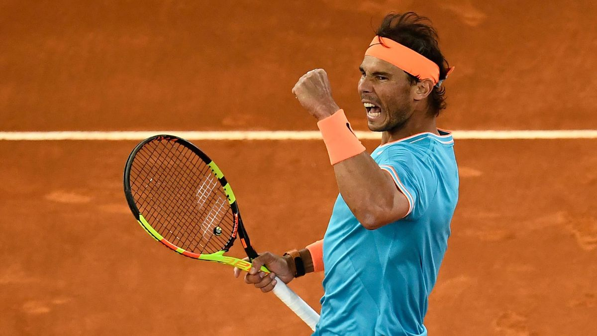 Spain's Rafael Nadal celebrates winning a point against Greece's Stefanos Tsitsipas during their ATP Madrid Open semi-final tennis match at the Caja Magica in Madrid on May 11, 2019.