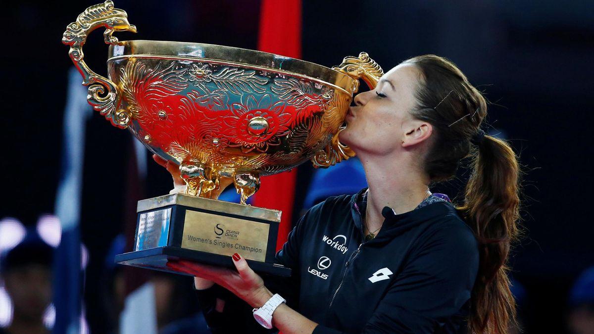 Tennis - China Open women's final - Beijing, China - 09/10/16. Poland's Agnieszka Radwanska holds the trophy after defeating Britain's Johanna Konta