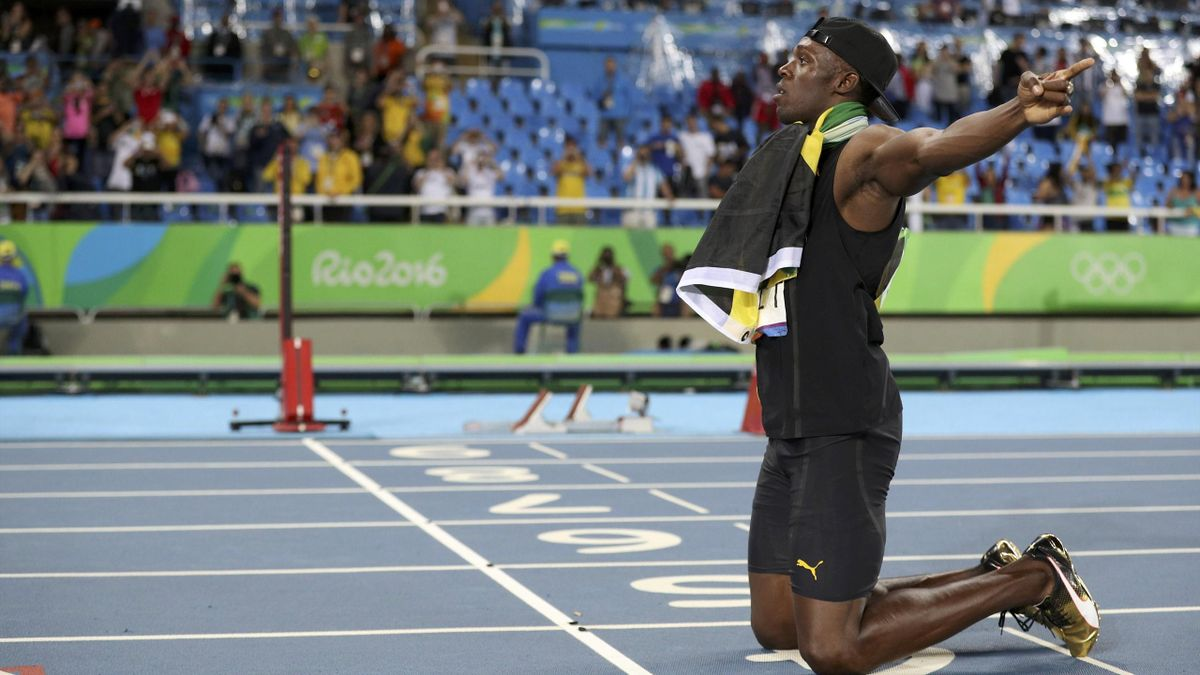 Usain Bolt (JAM) of Jamaica celebrates after his team won the gold