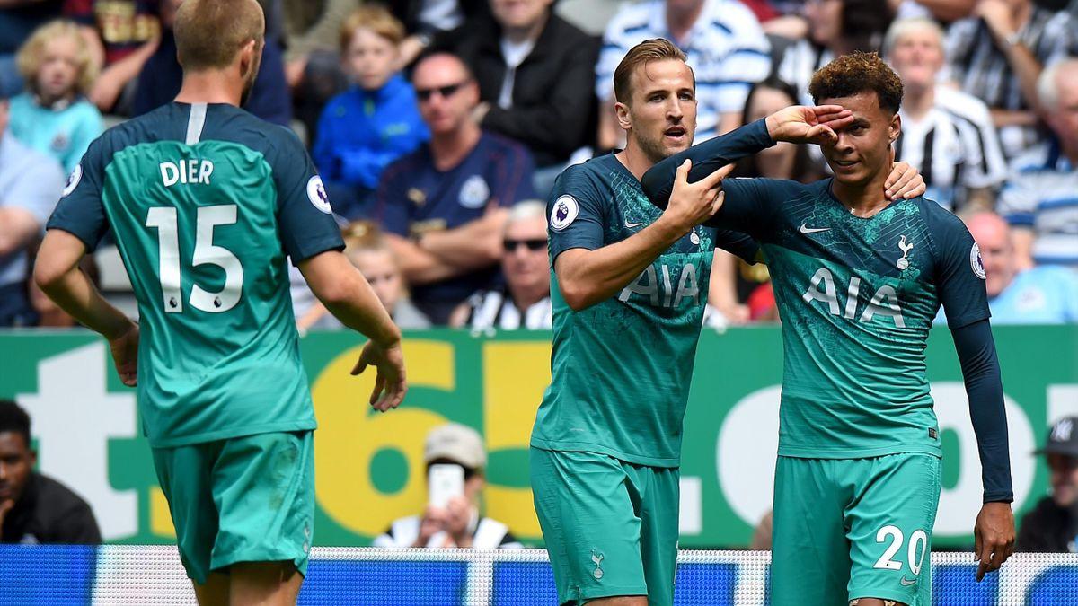 Dele Alli of Tottenham Hotspur celebrates with teammate Harry Kane