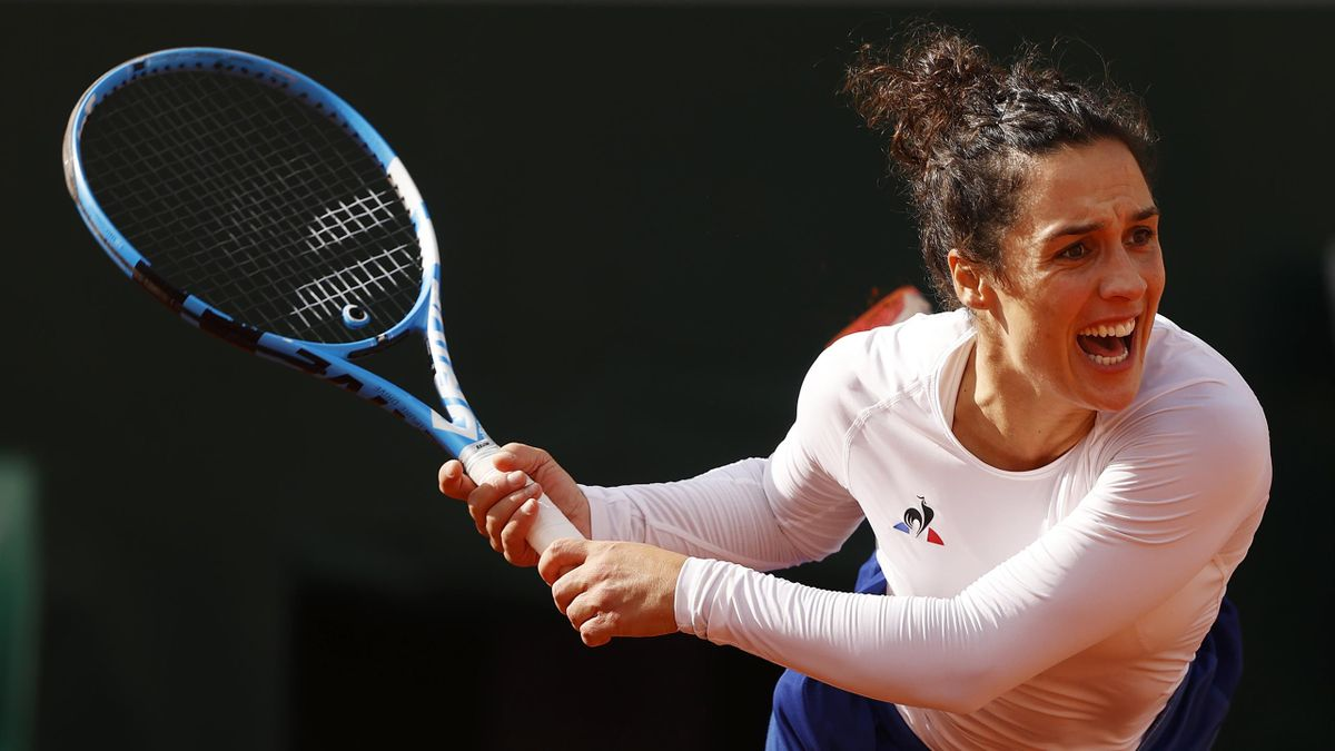 Martina Trevisan of Italy serves during her Women's Singles fourth round match against Kiki Bertens of the Netherlands on day eight of the 2020 French Open at Roland Garros on October 04, 2020 in Paris, France.