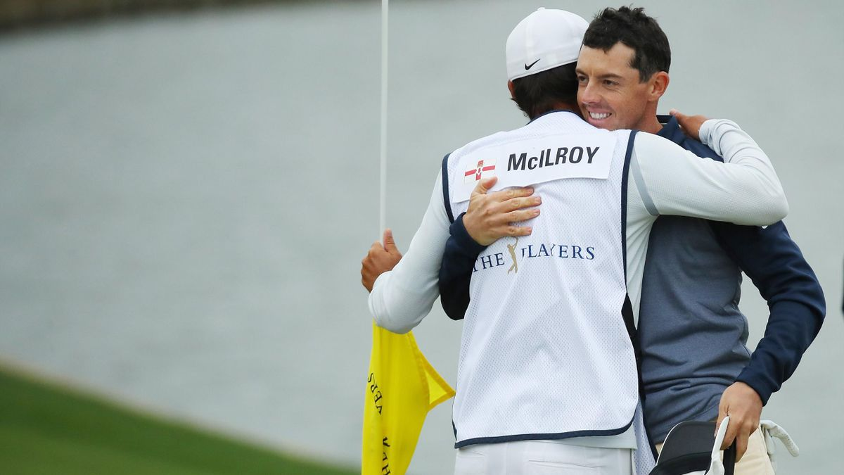 Rory McIlroy of Northern Ireland and caddie Harry Diamond celebrate after finishing on the 18th green during the final round of The PLAYERS Championship on The Stadium Course.