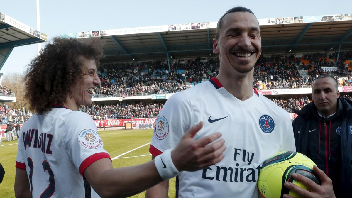 Paris St Germain players Zlatan Ibrahimovic (R) and David Liuiz celebrate their French Ligue 1 title after winning against Troyes.
