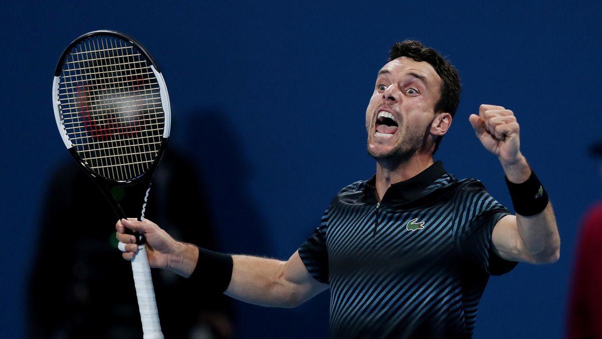 Roberto Bautista Agut celebrates after winning his semi final match against Serbia's Novak Djokovic