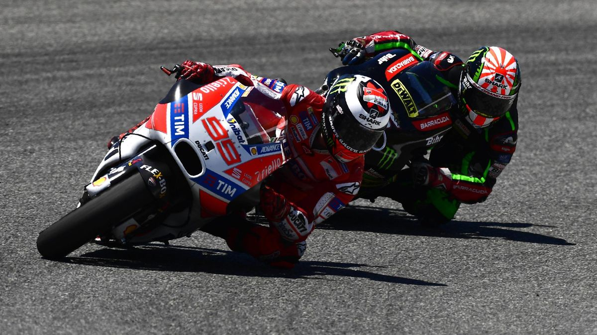 Ducati Team's Spanish rider Jorge Lorenzo (L) takes a curve ahead of Monster Yamaha Tech 3's French rider Johann Zarco during the Spanish Red Bull Grand Prix Moto GP race at Jerez de la Frontera race track on May 7, 2017.