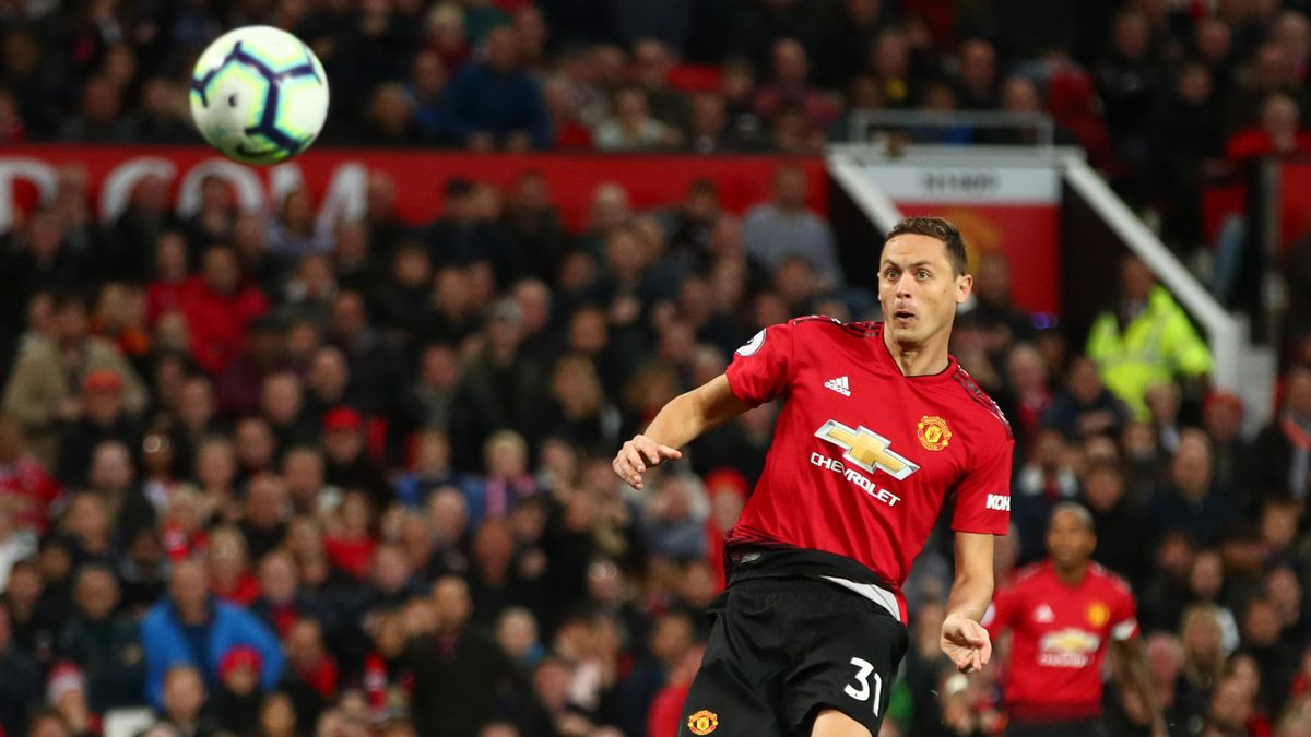 Manchester United's Serbian midfielder Nemanja Matic (R) misses a chance at goal during the English Premier League football match between Manchester United and Newcastle at Old Trafford in Manchester, north west England, on October 6, 2018.