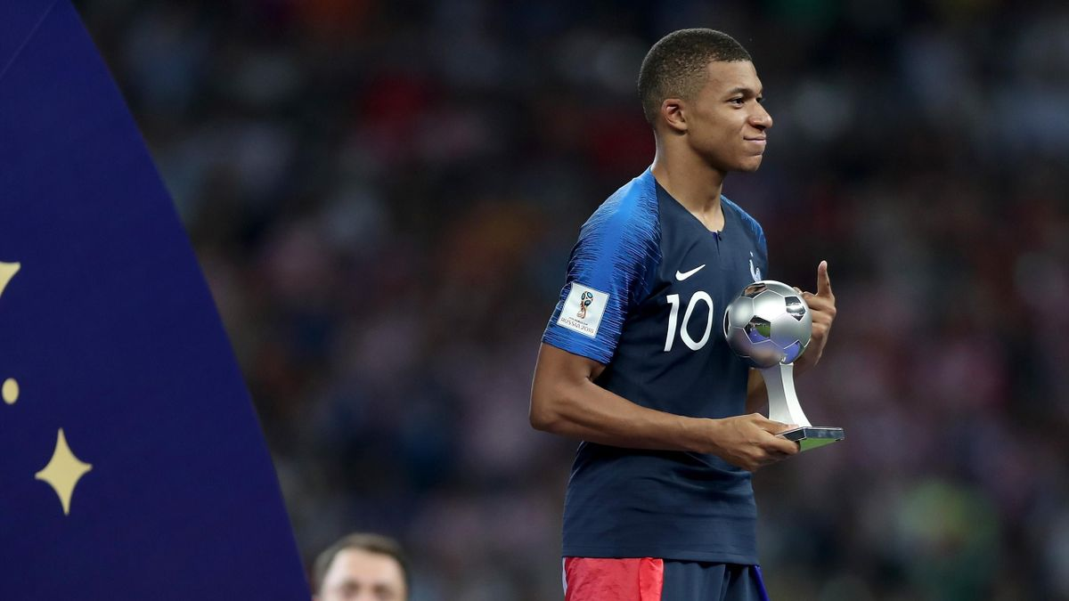 Kylian Mbappe of France receives the Best Young Player award following the 2018 FIFA World Cup Final between France and Croatia at Luzhniki Stadium on July 15, 2018 in Moscow, Russia.